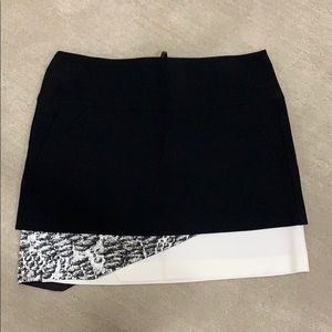 Black mini skirt by Helmut Lang. Business casual